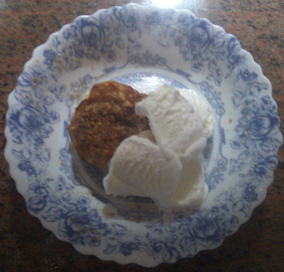 Cooked apples with walnuts and Vanilla Icecream